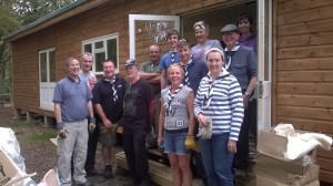 Everyone still smiling after finishing the building and clearing work at Bragger's wood